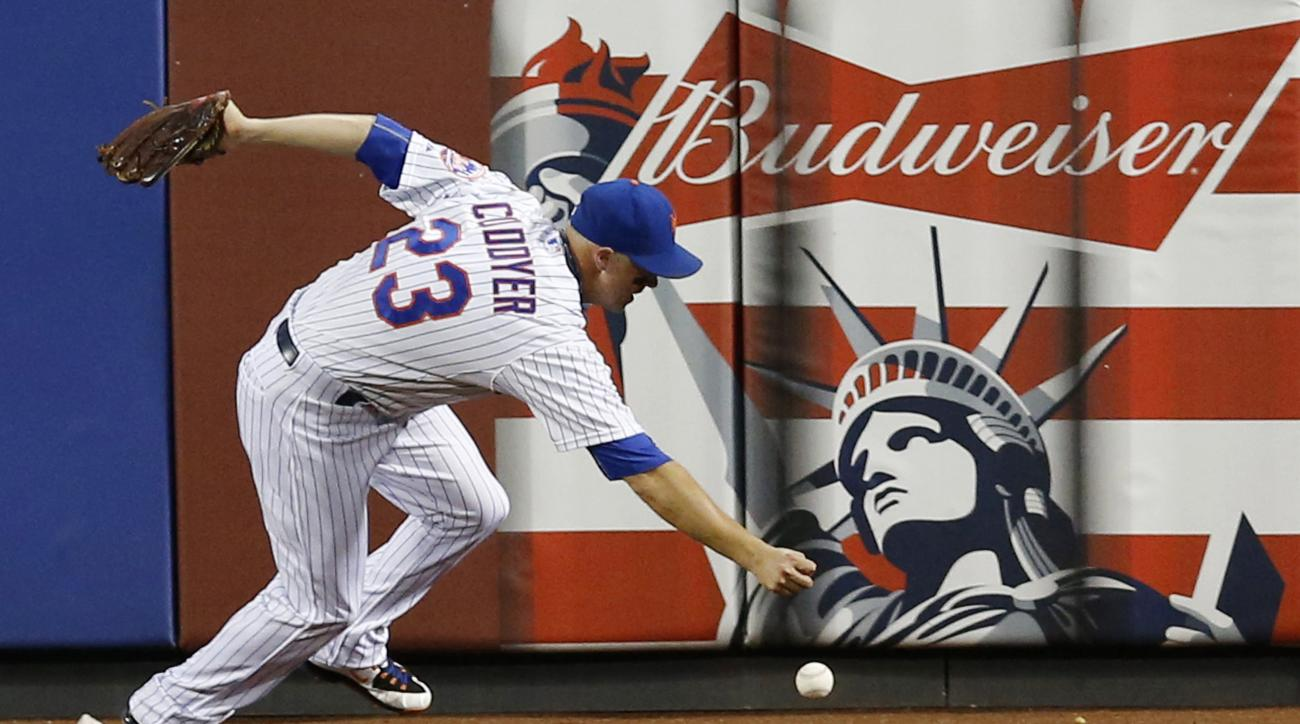 New York Mets left fielder Michael Cuddyer (23) fields Matt Szczur's sixth-inning RBI double after it bounced off the outfield wall in a baseball game in New York, Tuesday, June 30, 2015. (AP Photo/Kathy Willens)