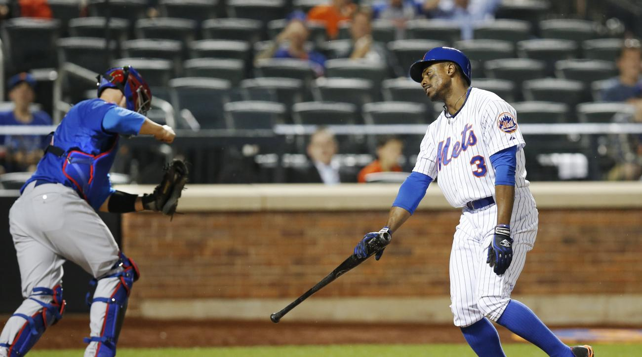 Chicago Cubs catcher David Ross, left,  pumps his fist as New York Mets Curtis Granderson (3) reacts after he struck out looking in the eighth-inning of a baseball game against the Chicago Cubs in New York, Tuesday, June 30, 2015. (AP Photo/Kathy Willens)