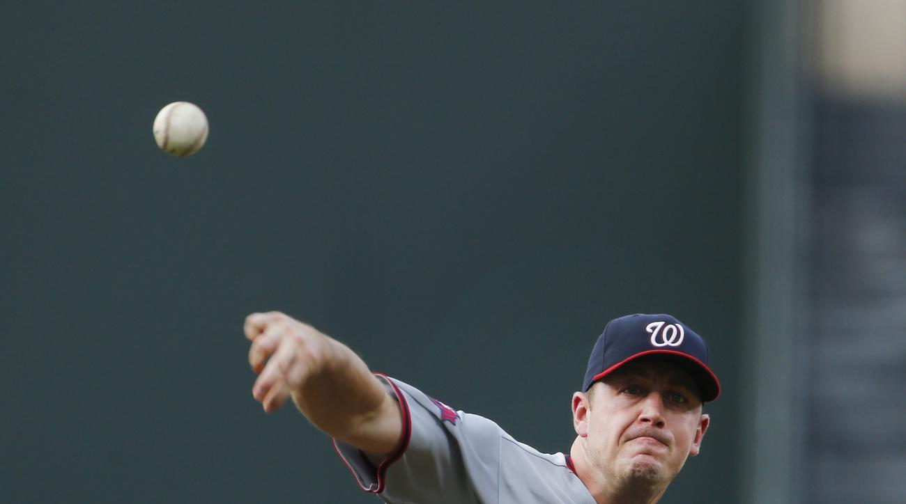 Washington Nationals starting pitcher Jordan Zimmermann (27) works in the first inning of a baseball game against the Atlanta Braves Tuesday, June 30, 2015, in Atlanta.  (AP Photo/John Bazemore)