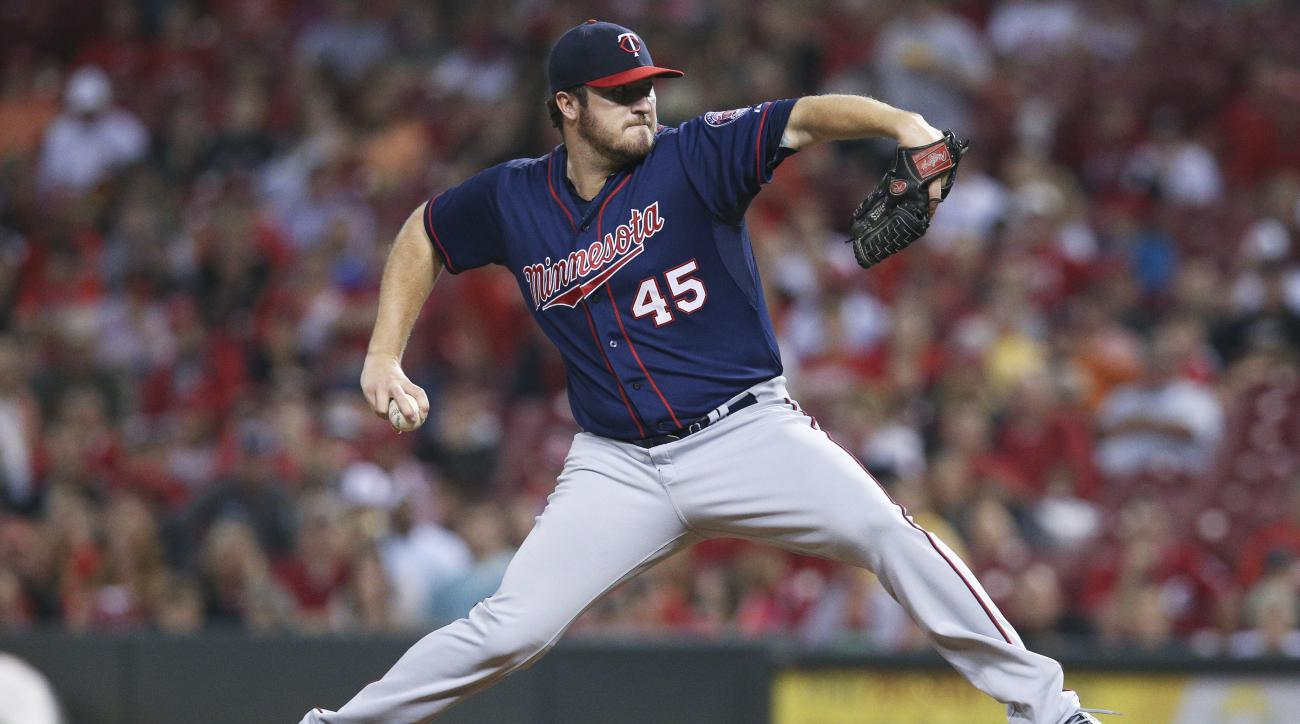 Minnesota Twins starting pitcher Phil Hughes throws in the second inning of a baseball game against the Cincinnati Reds, Tuesday, June 30, 2015, in Cincinnati. (AP Photo/John Minchillo)