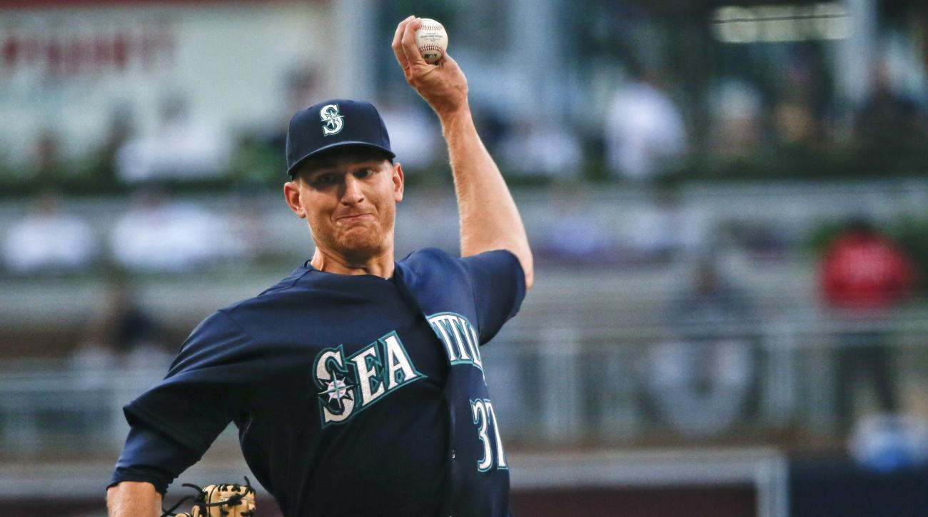 Seattle Mariners starting pitcher Mike Montgomery works against the San Diego Padres during the first inning of a baseball game Tuesday, June 30, 2015, in San Diego. (AP Photo/Lenny Ignelzi)