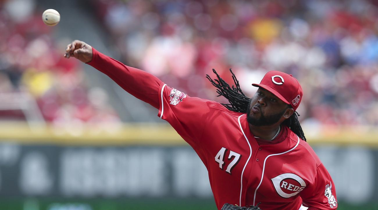 Cincinnati Reds starting pitcher Johnny Cueto throws in the second inning of a baseball game against the Minnesota Twins, Wednesday, July 1, 2015, in Cincinnati. (AP Photo/John Minchillo)