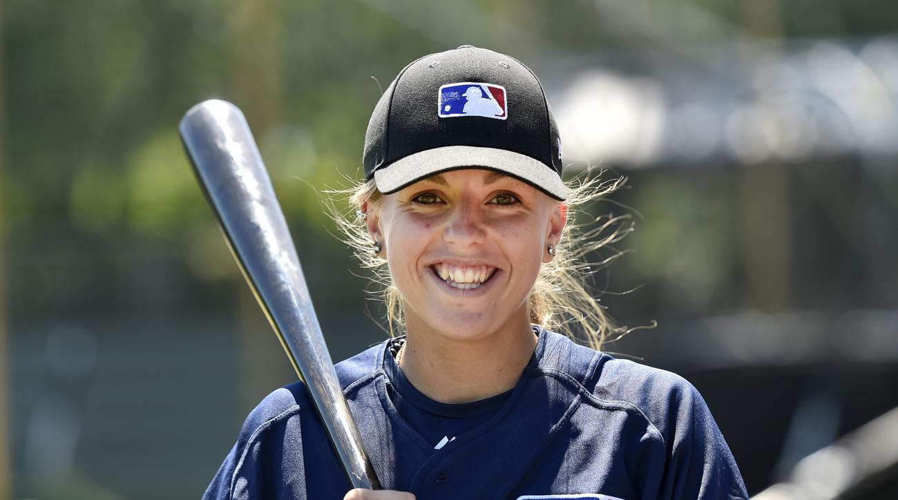 Melissa Mayeux smiles as she poses at a baseball camp in Paderborn, Germany, Wednesday, July 1, 2015. The 16-year-old player on the French U-18 junior national team, made history when she became the first woman on Major League Baseball's international reg