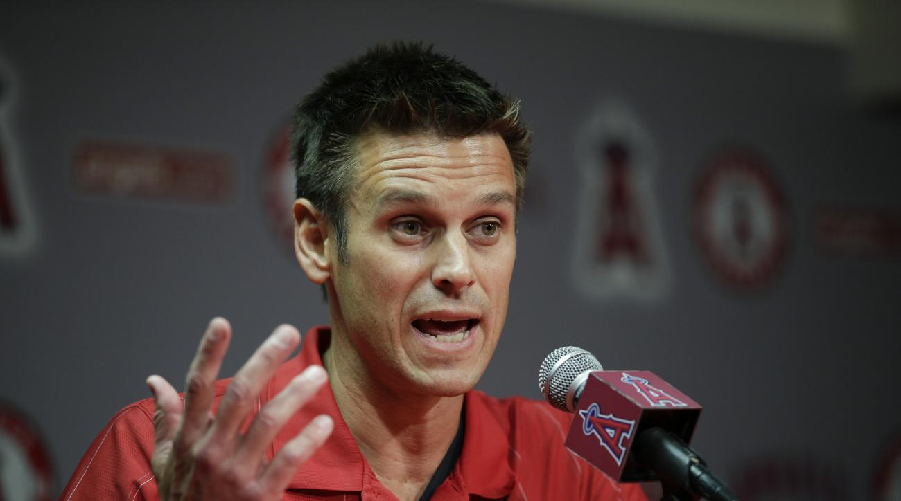 Los Angeles Angels General Manager Jerry Dipoto speaks to reporters during a news conference held before the team's exhibition baseball game against the Los Angeles Dodgers, Friday, April 3, 2015, in Anaheim, Calif. The Angels were surprised and disappoin