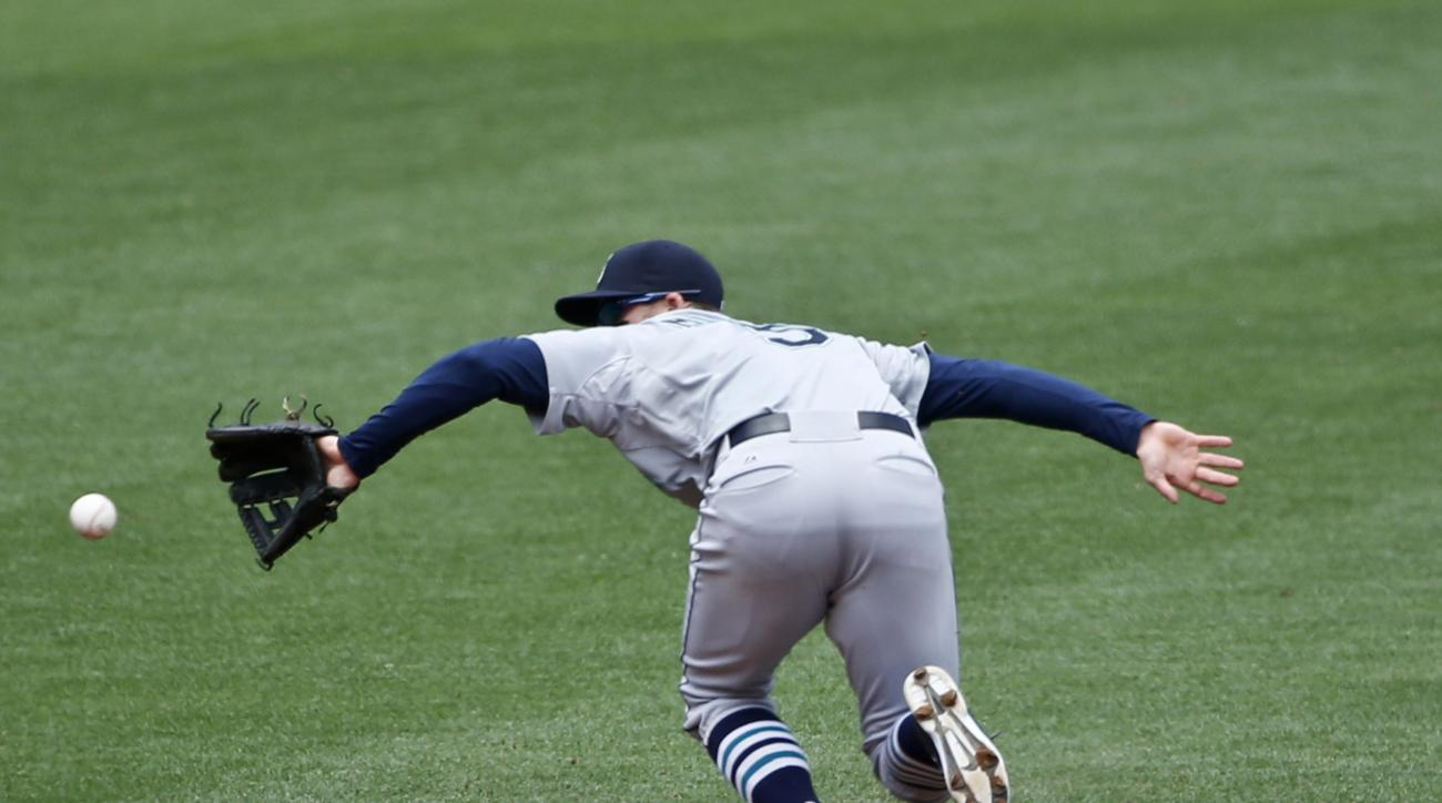 Seattle Mariners shortstop Brad Miller makes the back hand stop on a hard grounder hit by San Diego Padres' Yangervis Solarte in the second inning  of a baseball game Wednesday, July 1, 2015, in San Diego. Miller got the out at first.   (AP Photo/Lenny Ig