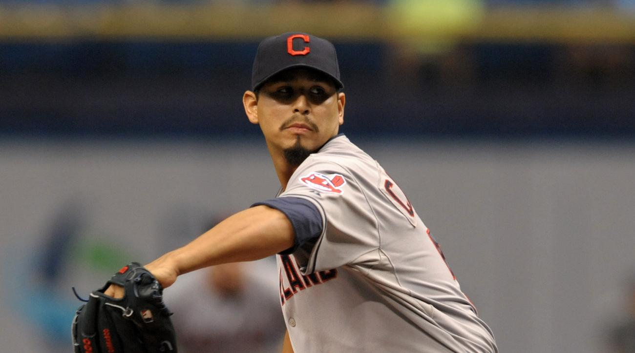 Cleveland Indians starter Carlos Carrasco pitches against the Tampa Bay Rays during the first inning of a baseball game Wednesday, July 1, 2015, in St. Petersburg, Fla. (AP Photo/Steve Nesius)