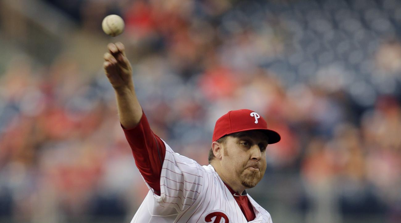 Philadelphia Phillies' Aaron Harang pitches during the third inning of a baseball game against the Milwaukee Brewers, Wednesday, July 1, 2015, in Philadelphia. (AP Photo/Matt Slocum)