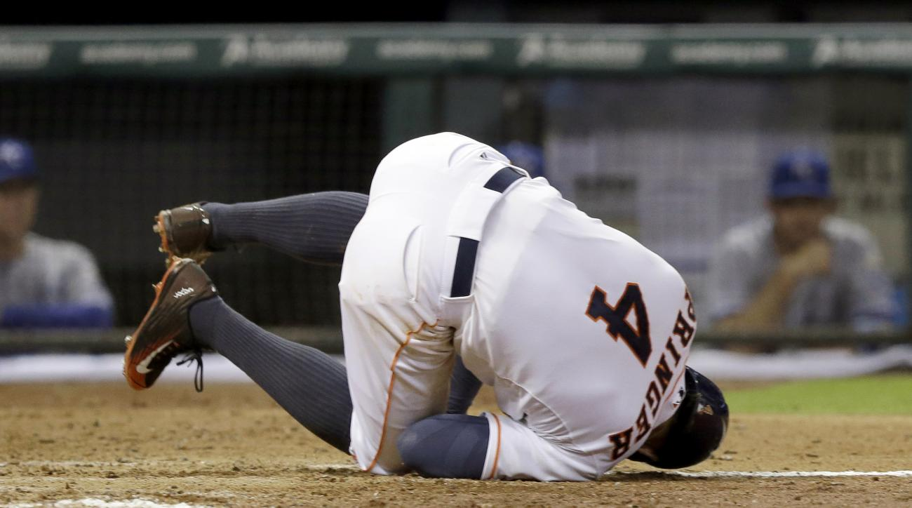 Houston Astros' George Springer hits the ground after being hit by a pitch against the Kansas City Royals in the fifth inning of a baseball game Wednesday, July 1, 2015, in Houston. (AP Photo/Pat Sullivan)