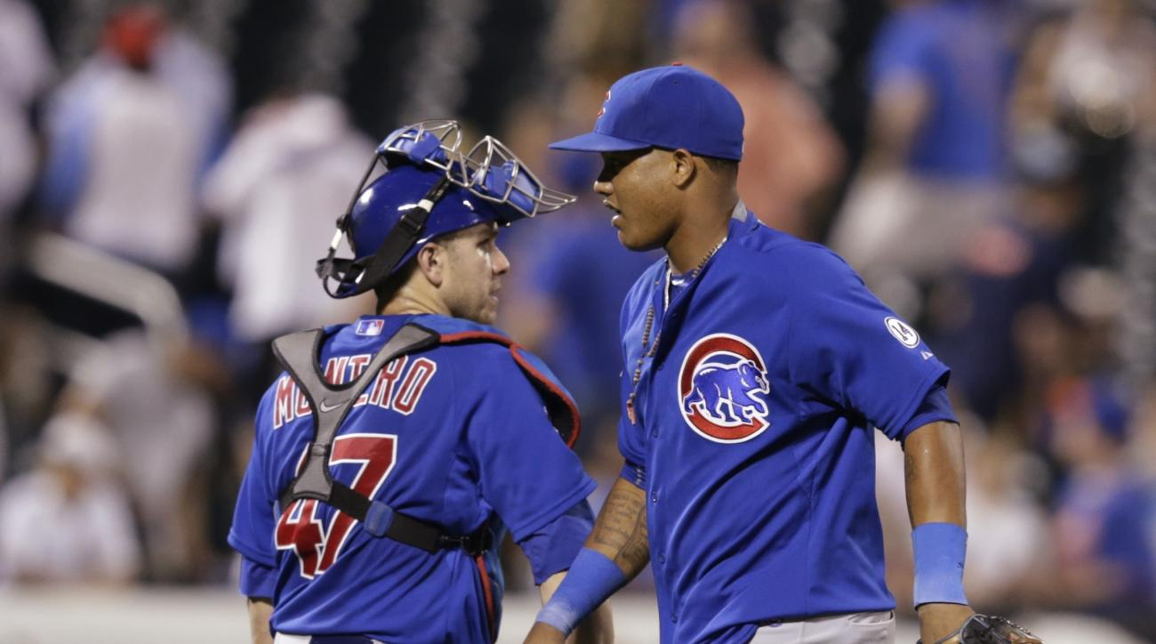 Chicago Cubs' Miguel Montero (47) and Starlin Castro (13) celebrate after a baseball game against the New York Mets Wednesday, July 1, 2015, in New York. The Cubs won 2-0. (AP Photo/Frank Franklin II)