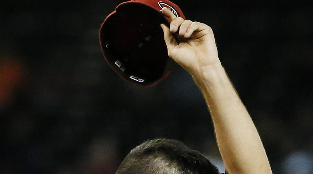 Arizona Diamondbacks' Robbie Ray wipes sweat from his face after giving up the third run to the Los Angeles Dodgers during the third inning of a baseball game Wednesday, July 1, 2015, in Phoenix. (AP Photo/Ross D. Franklin)