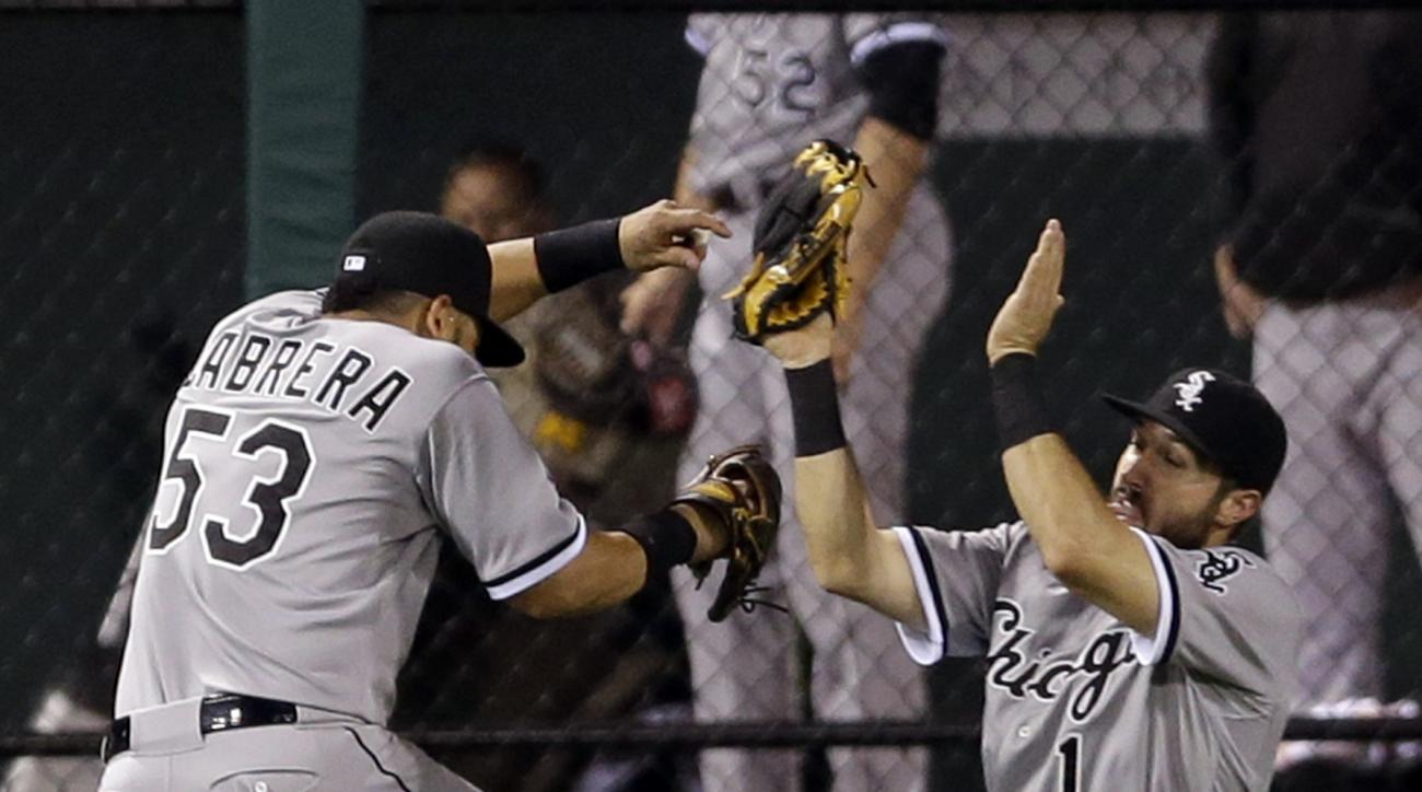 Chicago White Sox center fielder Adam Eaton, right, nearly collides with left fielder Melky Cabrera while catching a ball hit by St. Louis Cardinals' Matt Carpenter during the eighth inning of a baseball game early Thursday, July 2, 2015, in St. Louis. (A