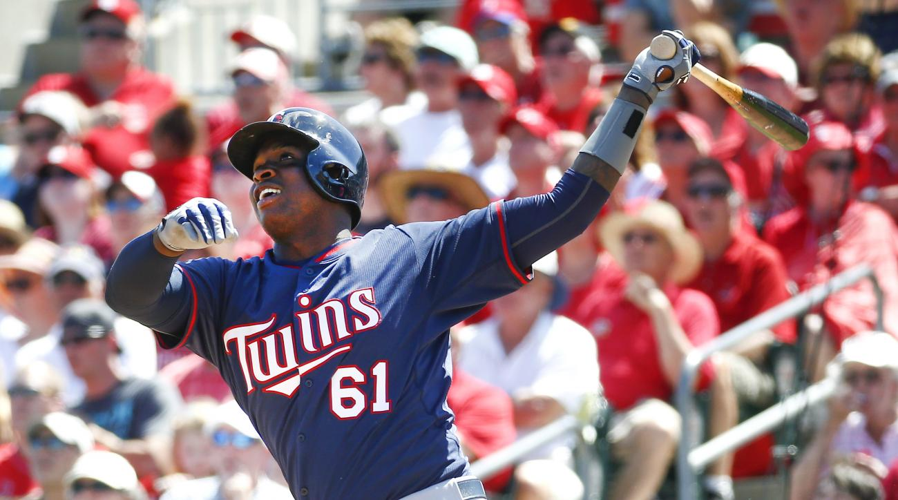 Minnesota Twins's Miguel Sano follows through on a two-run home run in the sixth inning of an exhibition spring training baseball game against the St. Louis Cardinals, Saturday, March 14, 2015, in Jupiter, Fla. (AP Photo/John Bazemore)