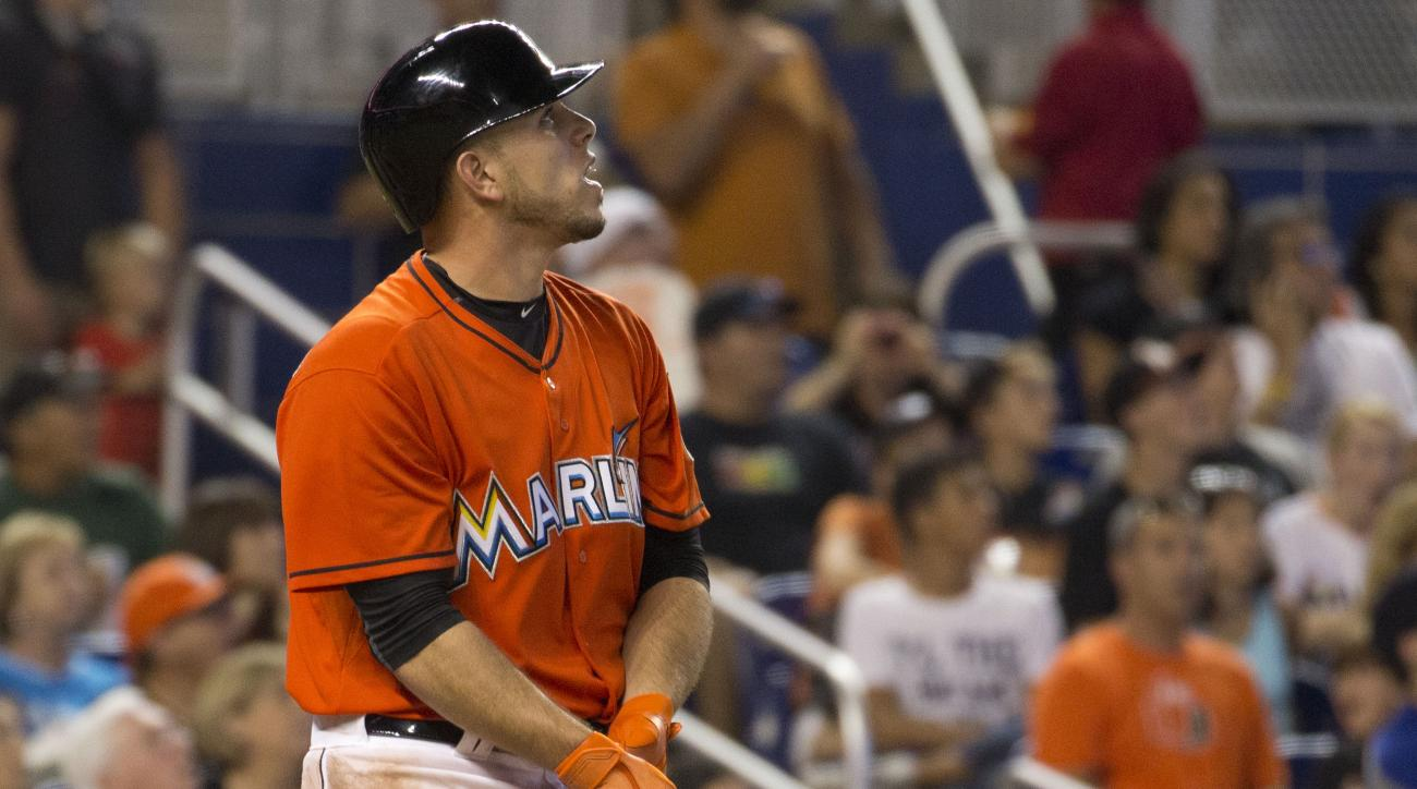Miami Marlins' Jose Fernandez (16) watches his home run during the fifth inning of a baseball game against the San Francisco Giants in Miami, Thursday, July 2, 2015. (AP Photo/J Pat Carter)