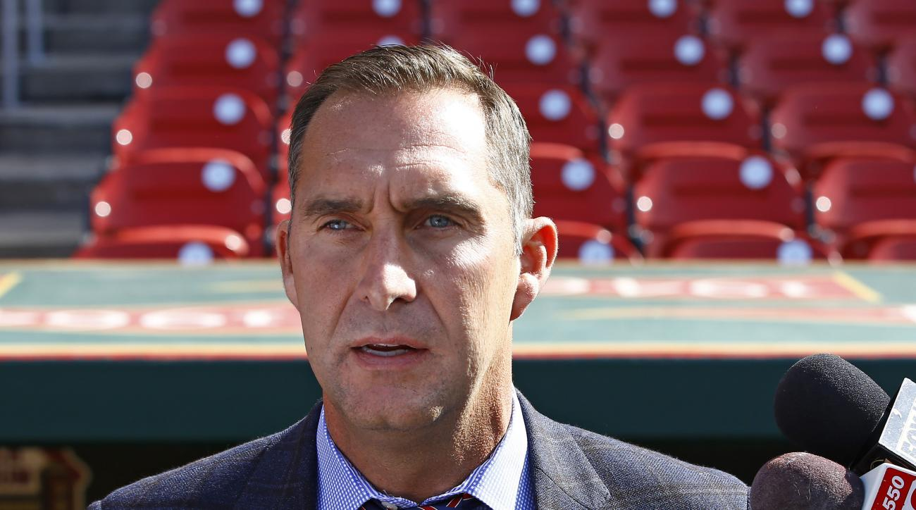 FILE - In this  Monday, April 27, 2015 file photo, St. Louis Cardinals General Manager John Mozeliak addresses members of the media prior to a baseball game against the Philadelphia Phillies, in St. Louis. The St. Louis Cardinals say they have fired scout