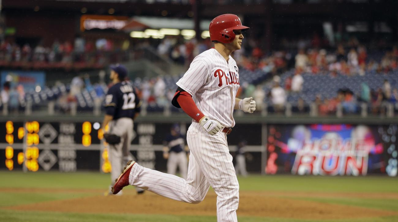 Philadelphia Phillies' Cody Asche, right, rounds the bases after hitting a two-run home run off Milwaukee Brewers starting pitcher Matt Garza, left, during the second inning of a baseball game, Thursday, July 2, 2015, in Philadelphia. (AP Photo/Matt Slocu