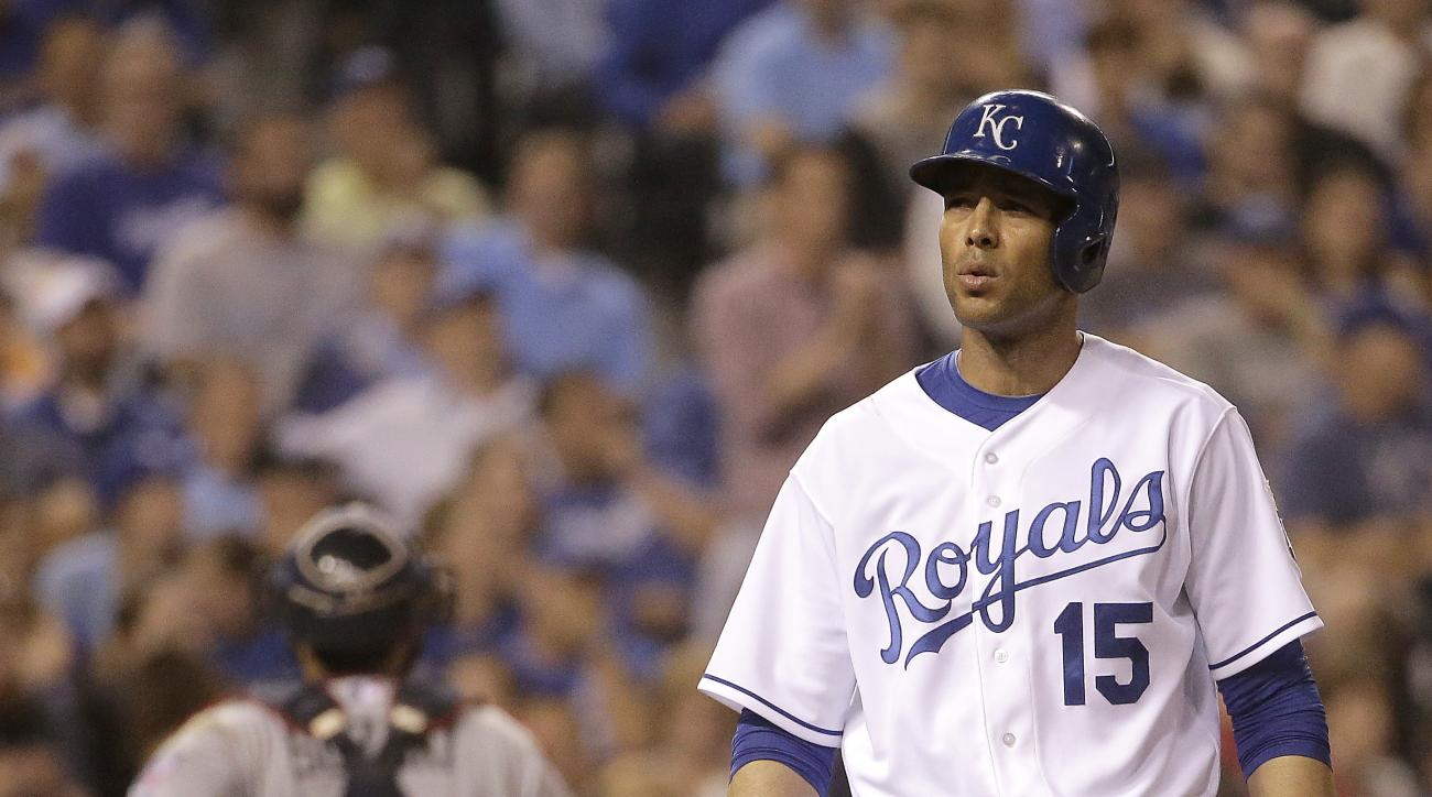 Kansas City Royals' Alex Rios walks away from home plate after striking out to end the seventh inning of a baseball game against the Minnesota Twins on Thursday, July 2, 2015, in Kansas City, Mo. (AP Photo/Charlie Riedel)