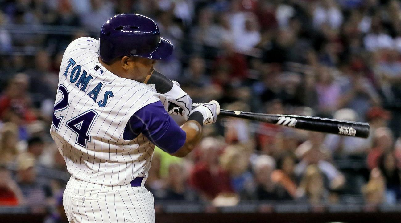 Arizona Diamondbacks' Yasmany Tomas follows through on a two-run double during the seventh inning of a baseball game against the Colorado Rockies, Thursday, July 2, 2015, in Phoenix. (AP Photo/Matt York)