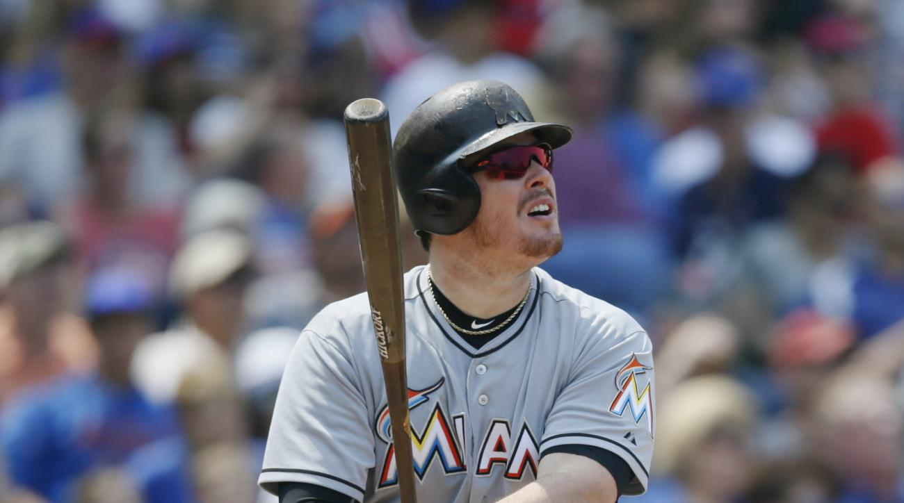 Miami Marlins first baseman Justin Bour (48) hits a solo home run against the Chicago Cubs during the sixth inning of a baseball game on Friday, July 3, 2015, in Chicago. (AP Photo/Andrew A. Nelles)