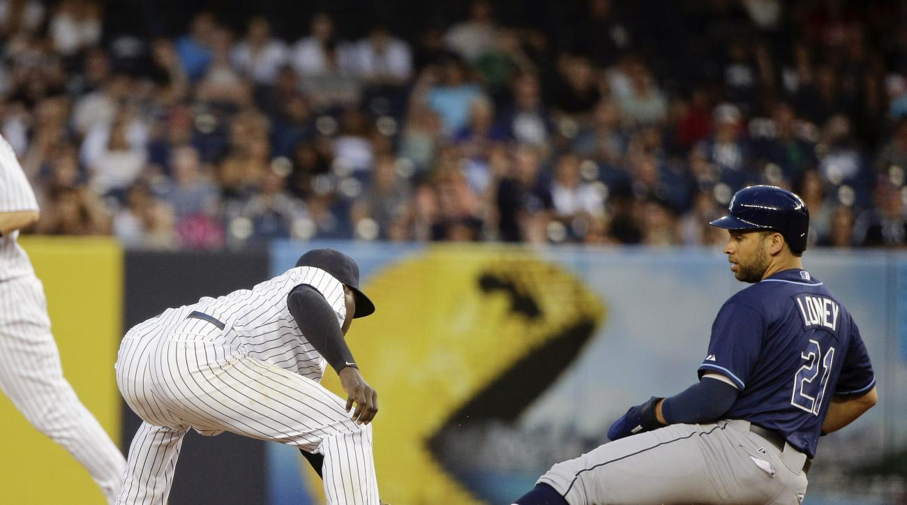 New York Yankees shortstop Didi Gregorius tags out Tampa Bay Rays James Loney (21) while caught off base in a botched hit and run during the fourth inning of a baseball game, Friday, July 3, 2015, in New York. (AP Photo/Julie Jacobson)