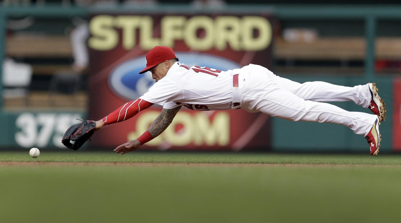 St. Louis Cardinals second baseman Kolten Wong can't reach a single hit by San Diego Padres' Will Venable during the second inning of a baseball game Friday, July 3, 2015, in St. Louis. (AP Photo/Jeff Roberson)