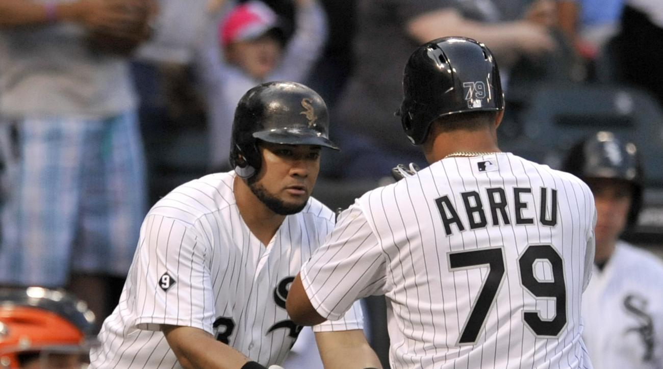 Chicago White Sox's Jose Abreu (79) celebrates with teammate Melky Cabrera after hitting a solo home run during the third inning of a baseball game against the Baltimore Orioles on Friday, July 3, 2015, in Chicago. (AP Photo/Paul Beaty)