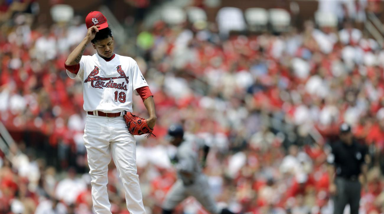 St. Louis Cardinals starting pitcher Carlos Martinez stands on the mound after giving up a solo home run to San Diego Padres' Yangervis Solarte during the fourth inning of a baseball game Saturday, July 4, 2015, in St. Louis. (AP Photo/Jeff Roberson)