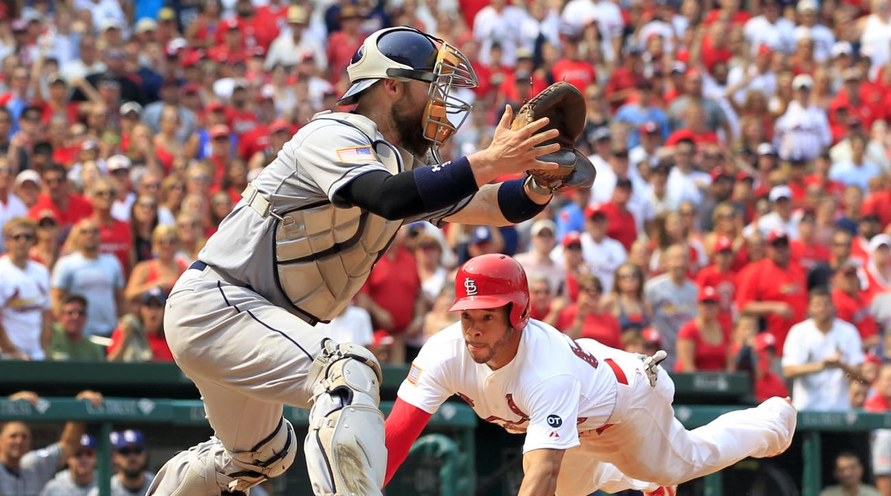 St. Louis Cardinals' Tommy Pham, right, scores past San Diego Padres catcher Derek Norris during the eighth inning of a baseball game Saturday, July 4, 2015, in St. Louis. The Cardinals won 2-1. (AP Photo/Jeff Roberson)