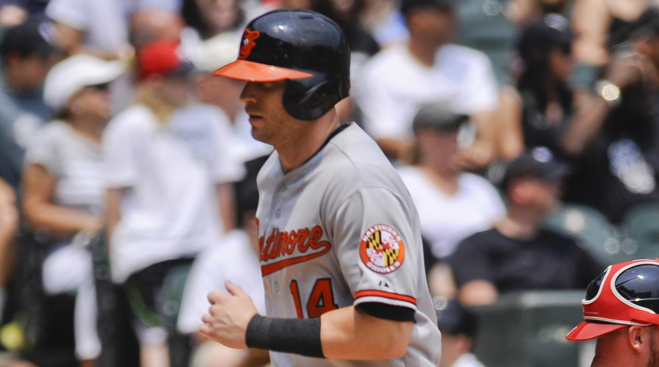 Baltimore Orioles' Nolan Reimold scores on an RBI-double by Adam Jones during the first inning of a baseball game against the Chicago White Sox in Chicago on Sunday, July 5, 2015. (AP Photo/Matt Marton)