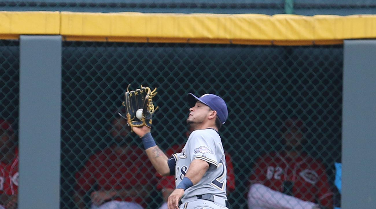 Milwaukee Brewers' center fielder Gerardo Parra runs down a fly ball off the bat of Cincinnati Reds' Tucker Barnhart during the third inning of a baseball game Sunday, July 5, 2015, in Cincinnati. (AP Photo/Gary Landers)