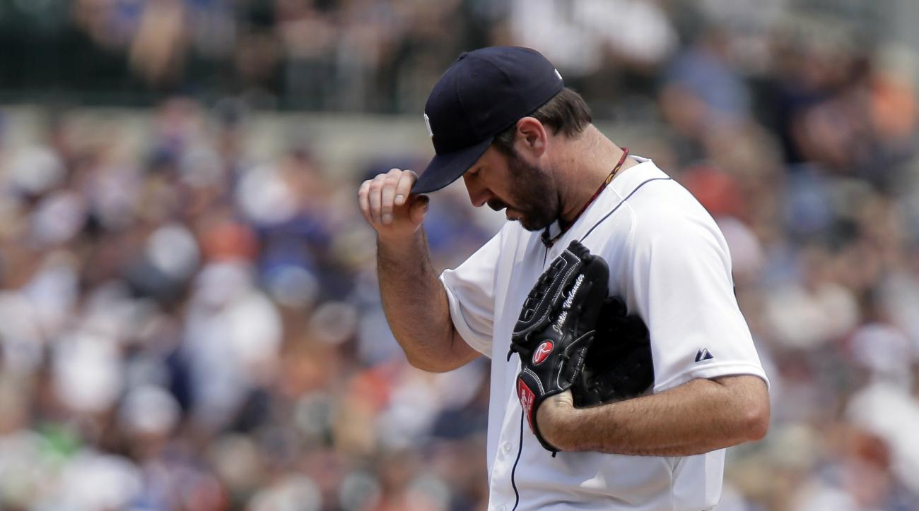 Detroit Tigers pitcher Justin Verlander kicks at the mound after giving up a solo home run to Toronto Blue Jays' Justin Smoak during the fifth inning of a baseball game Sunday, July 5, 2015, in Detroit. (AP Photo/Duane Burleson)