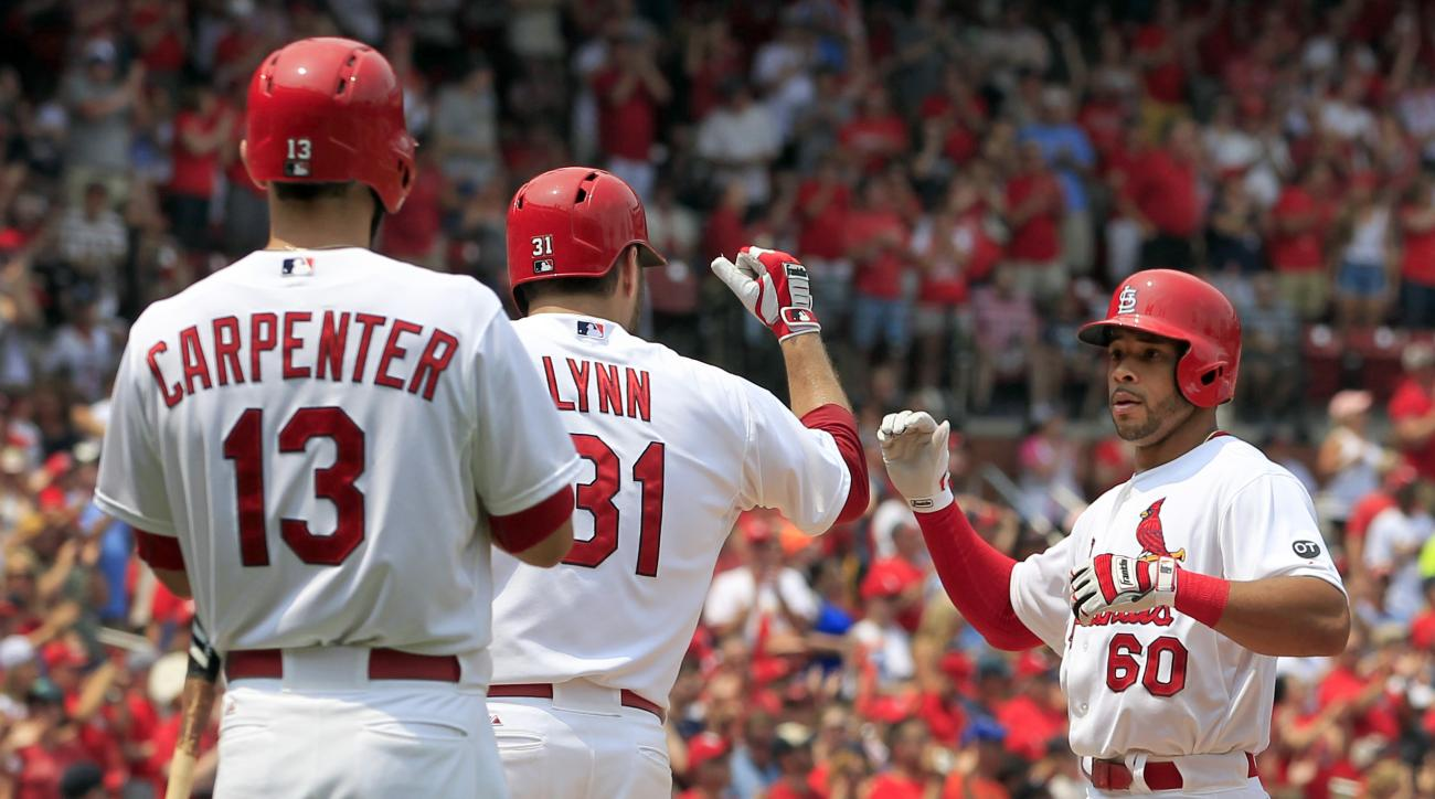 St. Louis Cardinals' Tommy Pham, right, is congratulated by teammates Lance Lynn and Matt Carpenter, left, after hitting a two-run home run during the third inning of a baseball game against the San Diego Padres, Sunday, July 5, 2015, in St. Louis. (AP Ph