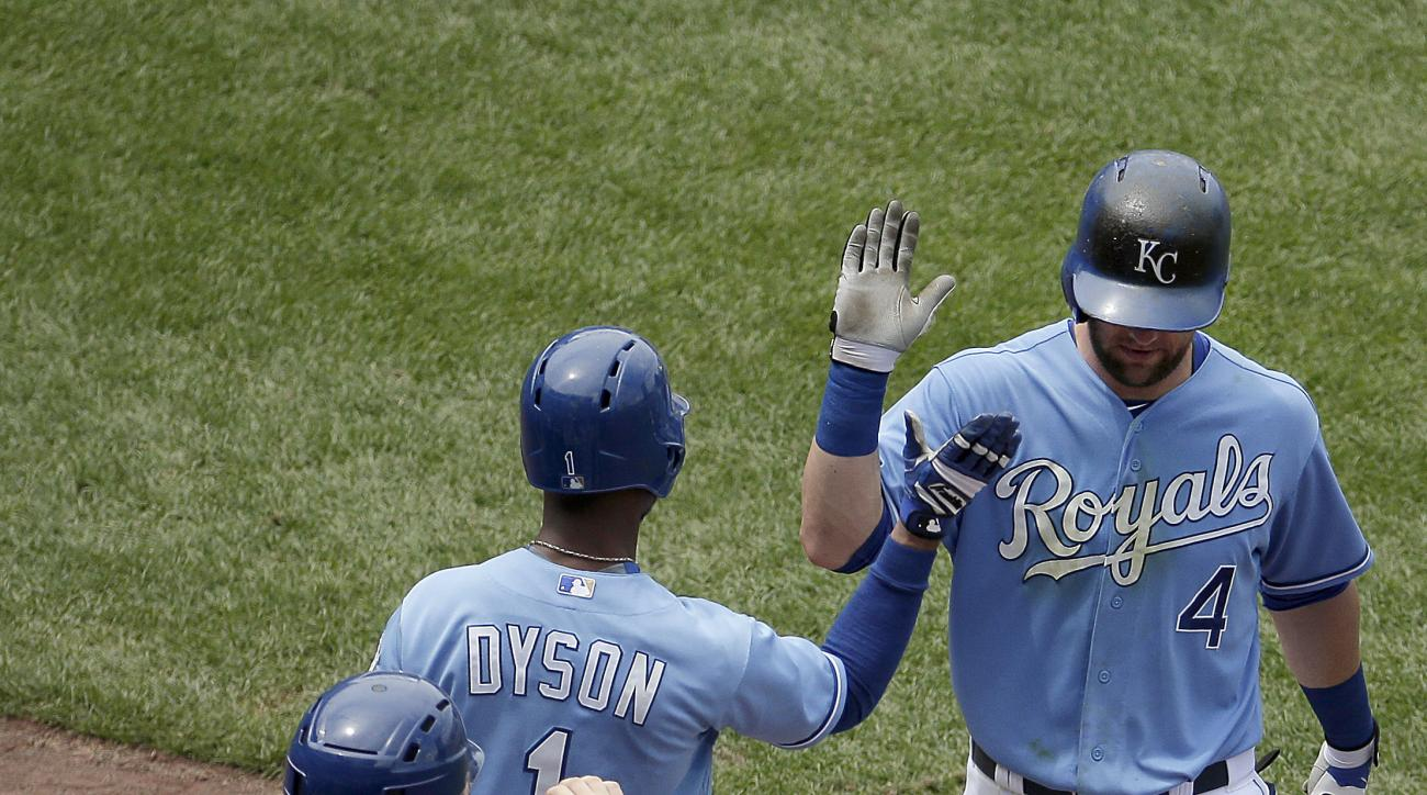 Kansas City Royals' Alex Gordon (4) celebrates with teammate Jarrod Dyson (1) after hitting a solo home run during the fifth inning of a baseball game against the Minnesota Twins, Sunday, July 5, 2015, in Kansas City, Mo. (AP Photo/Charlie Riedel)