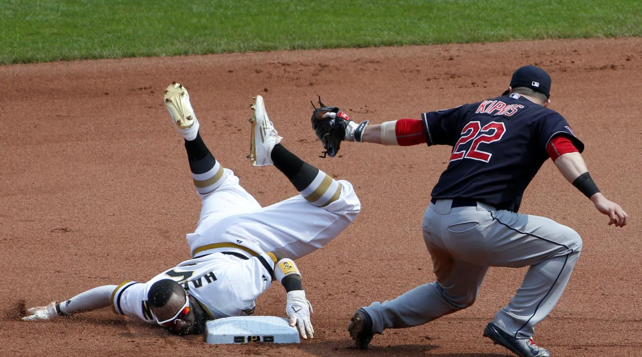 Pittsburgh Pirates' Josh Harrison (5) holds the second base bag as he steals second ahead of the tag by Cleveland Indians second baseman Jason Kipnis (22) during the seventh inning of a baseball game in Pittsburgh Sunday, July 5, 2015.(AP Photo/Gene J. Pu
