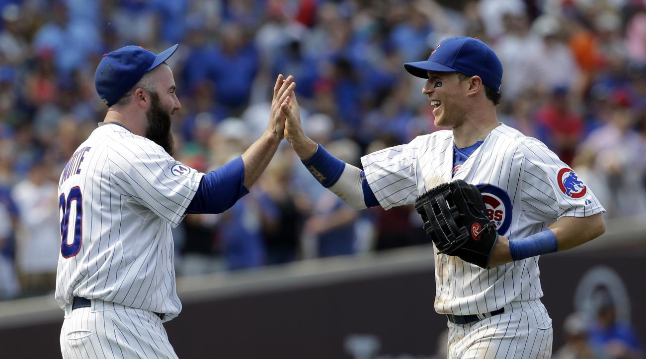 Chicago Cubs' Chris Coghlan, right, celebrates with relief Jason Motte after the Chicago Cubs defeated the Miami Marlins 2-0 in a baseball game Sunday, July 5, 2015, in Chicago. The Cubs won 2-0. (AP Photo/Nam Y. Huh)