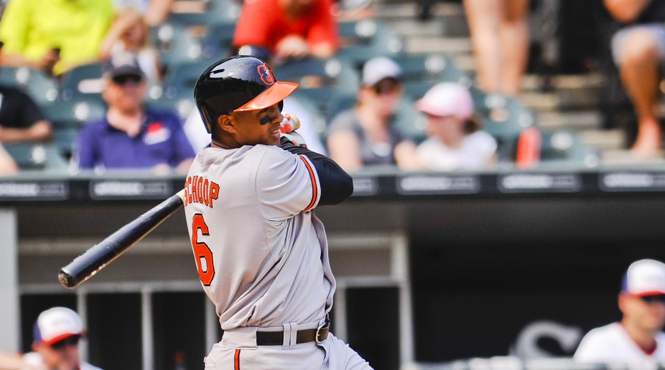 Baltimore Orioles' Jonathan Schoop hits a single during the seventh inning of a baseball game against the Chicago White Sox in Chicago on Sunday, July 5, 2015. (AP Photo/Matt Marton)
