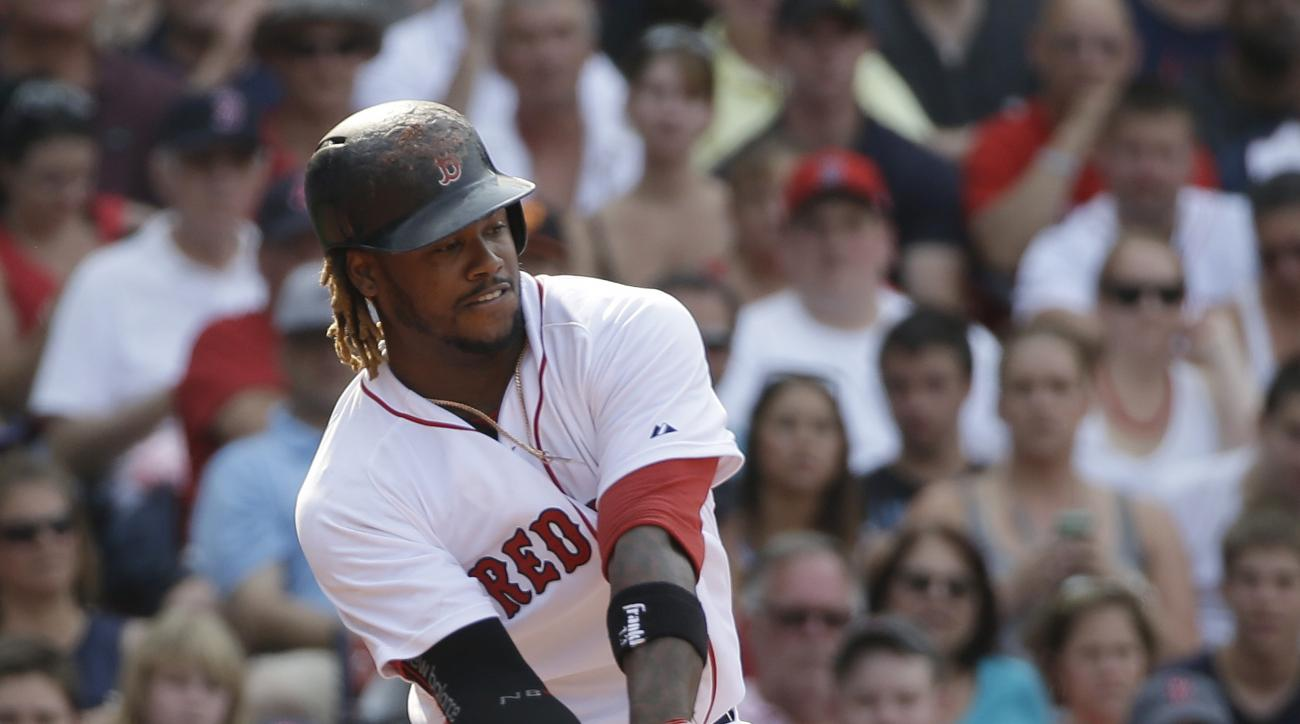Boston Red Sox's Hanley Ramirez hits a two-run home run in the seventh inning of a baseball game against the Houston Astros at Fenway Park, Sunday, July 5, 2015, in Boston. (AP Photo/Steven Senne)