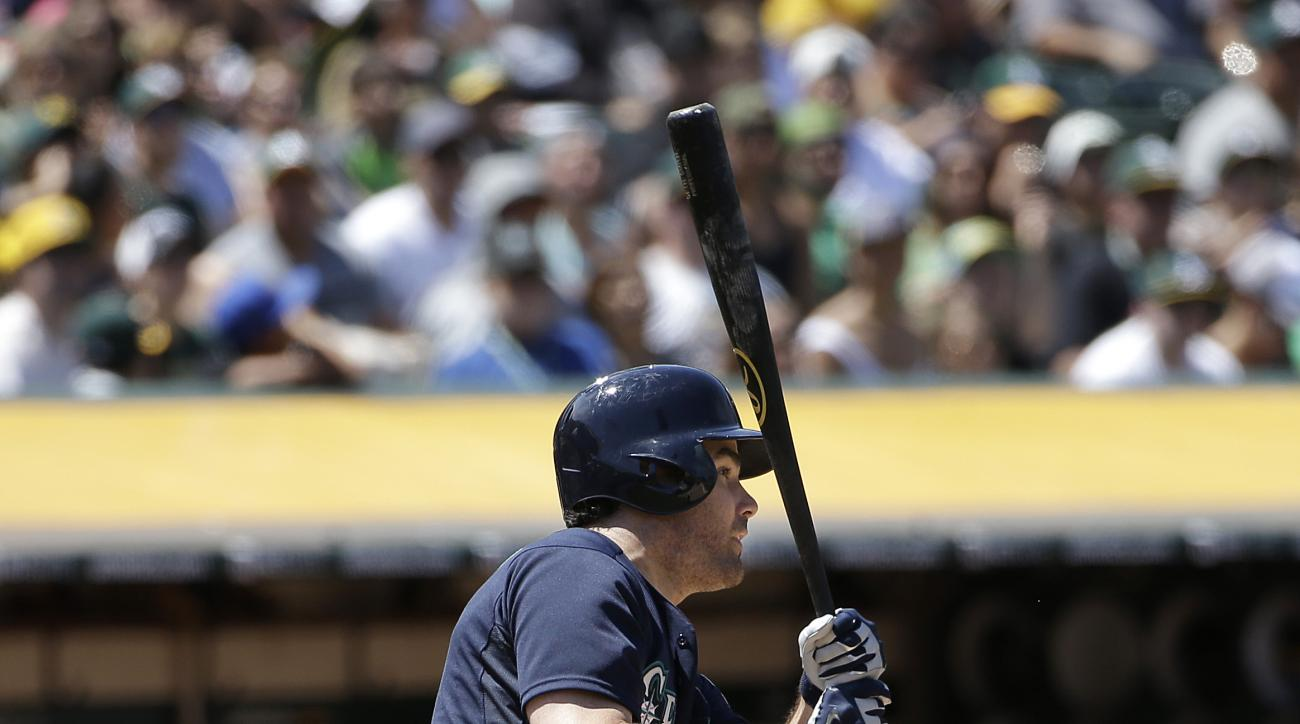 Seattle Mariners' Seth Smith hits a two-run single against the Oakland Athletics during the sixth inning of a baseball game in Oakland, Calif., Sunday, July 5, 2015. (AP Photo/Jeff Chiu)