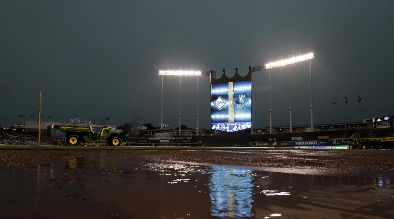 Rainwater pools on the field at Kauffman Stadium before a baseball game between the Kansas City Royals and the Tampa Bay Rays Monday, July 6, 2015, in Kansas City, Mo. The game was postponed and will be replayed Tuesday as the first game of a doubleheader