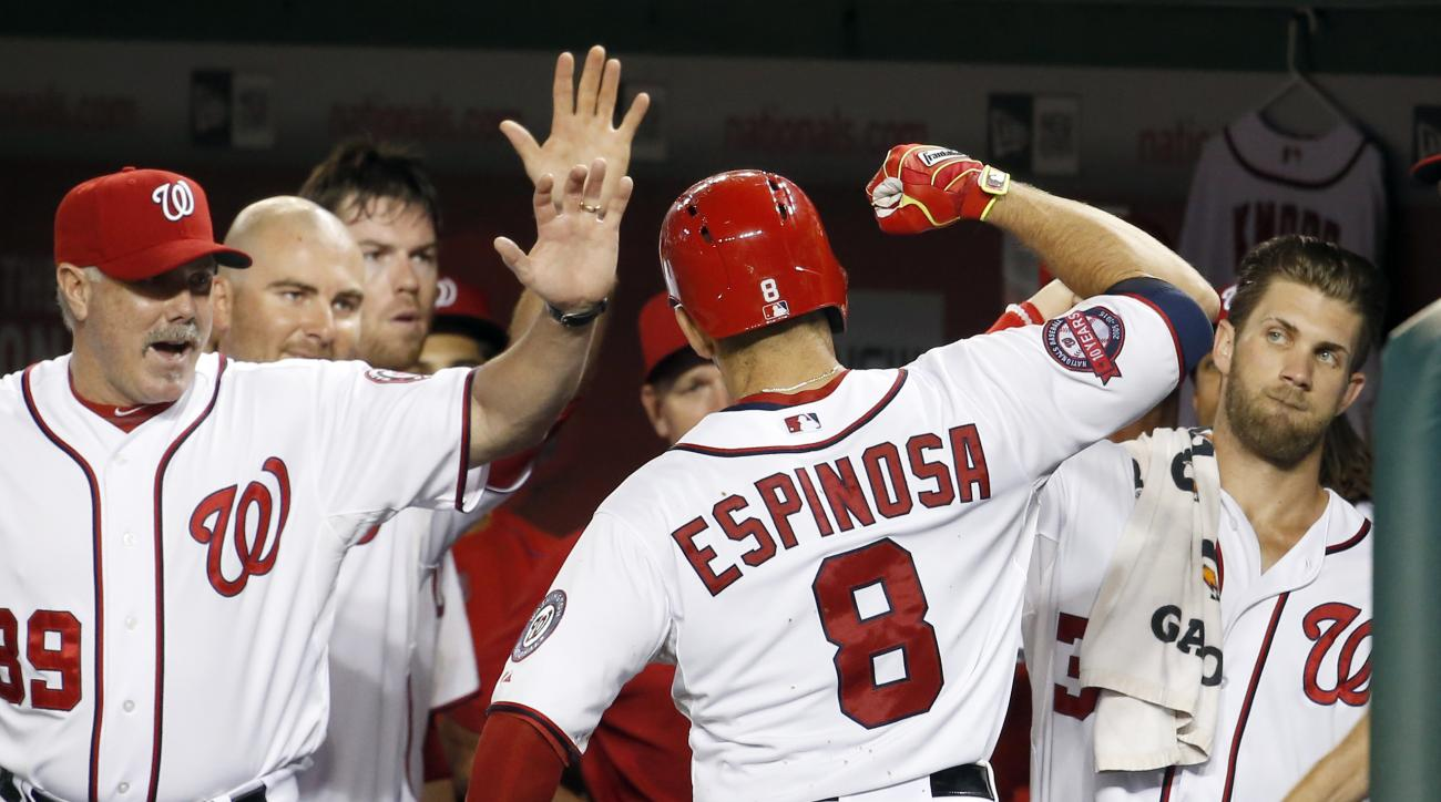 Washington Nationals' Danny Espinosa (8) celebrates his solo home run with Bryce Harper, right, and others during the sixth inning of a baseball game against the Cincinnati Reds at Nationals Park, Monday, July 6, 2015, in Washington. (AP Photo/Alex Brando
