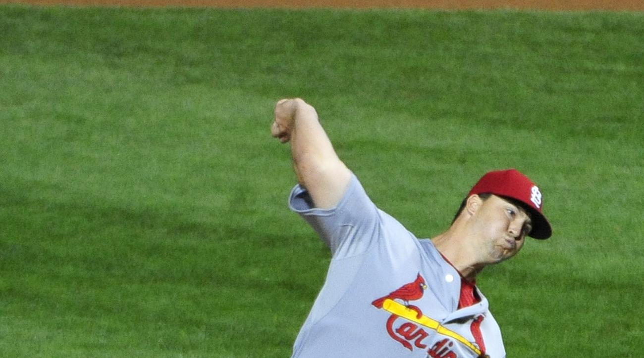 St. Louis Cardinals relief pitcher Mitch Harris (40) throws against the Chicago Cubs during the ninth inning of a baseball game, Monday, July  6, 2015, in Chicago. The Cardinals won 6-0. (AP Photo/David Banks)