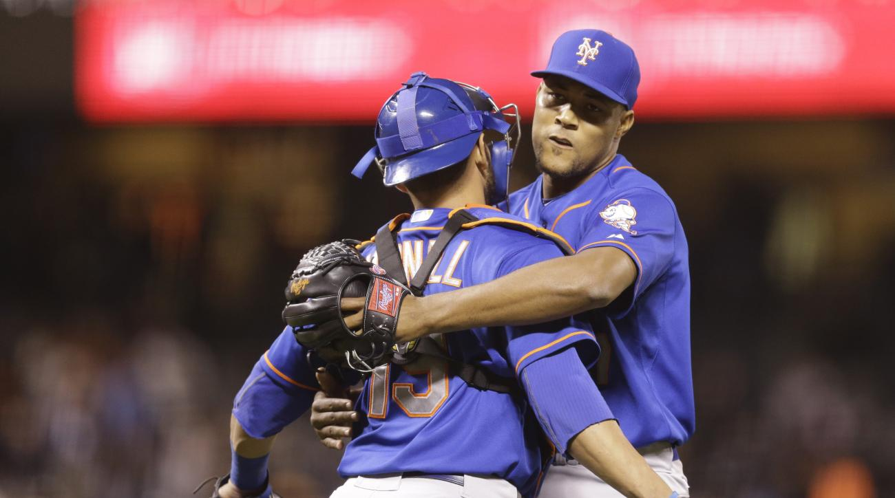 New York Mets relief pitcher Jeurys Familia, right, and Johnny Monell celebrate a 3-0 win over the San Francisco Giants at the end of a baseball game Monday, July 6, 2015, in San Francisco. (AP Photo/Ben Margot)