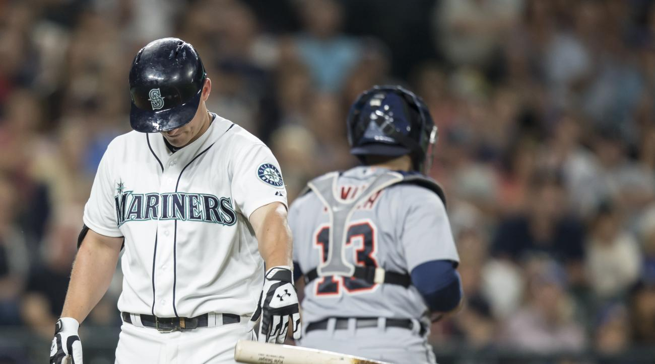 Seattle Mariners' Kyle Seager throws down his bat after striking out in the sixth inning of a baseball game against the Detroit Tigers, Monday, July 6, 2015, in Seattle. (AP Photo/Stephen Brashear)