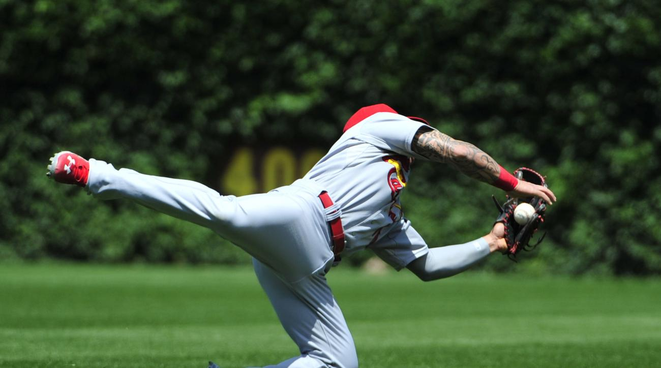 St. Louis Cardinals second baseman Kolten Wong (16) makes a catch for the out on a ball hit by Chicago Cubs' Miguel Montero during the fifth inning in the first baseball game of a doubleheader, Tuesday, July  7, 2015, in Chicago.  (AP Photo/David Banks)