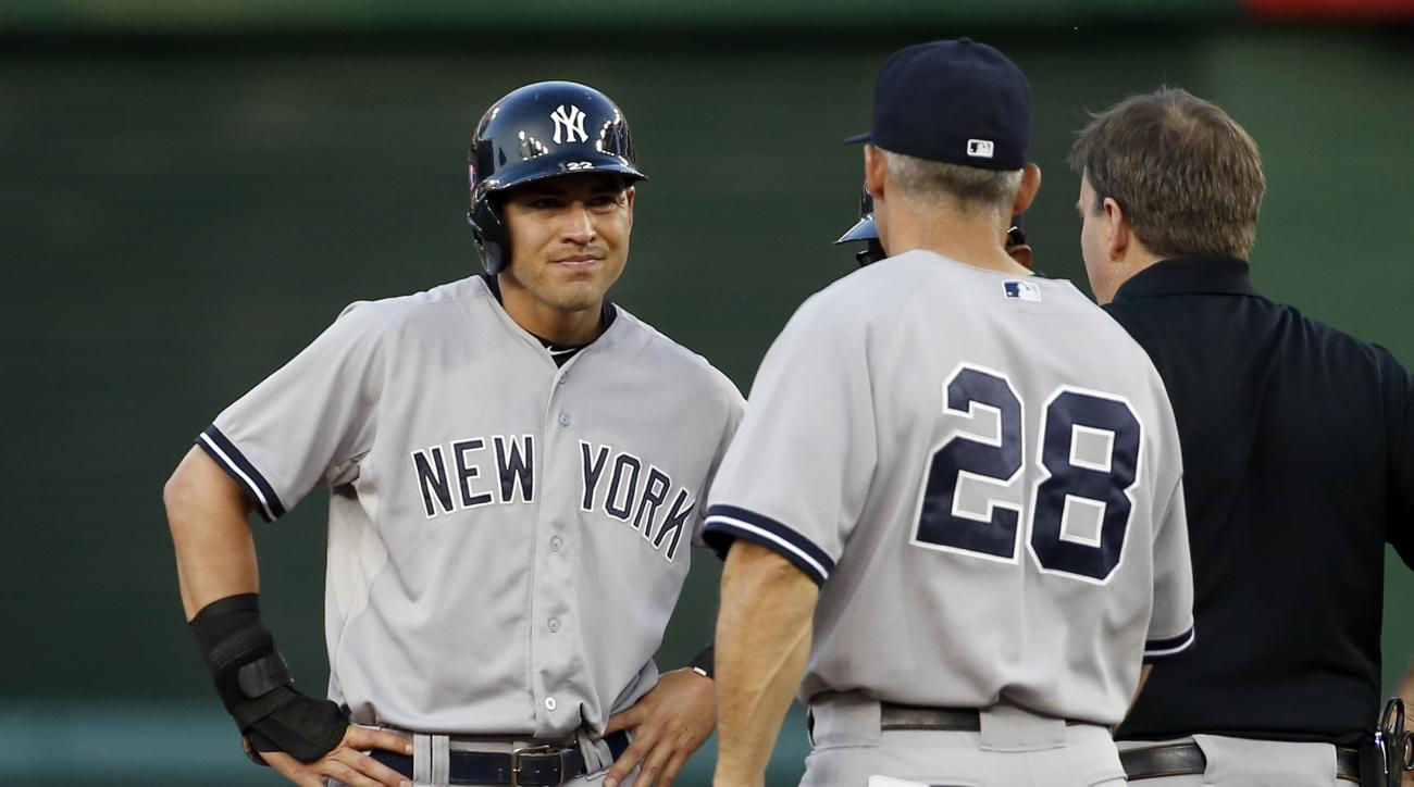 New York Yankees center fielder Jacoby Ellsbury (22) stands on second as New York Yankees manager Joe Girardi (28) comes out to talk during an interleague baseball game against the Washington Nationals at Nationals Park, Tuesday, May 19, 2015, in Washingt
