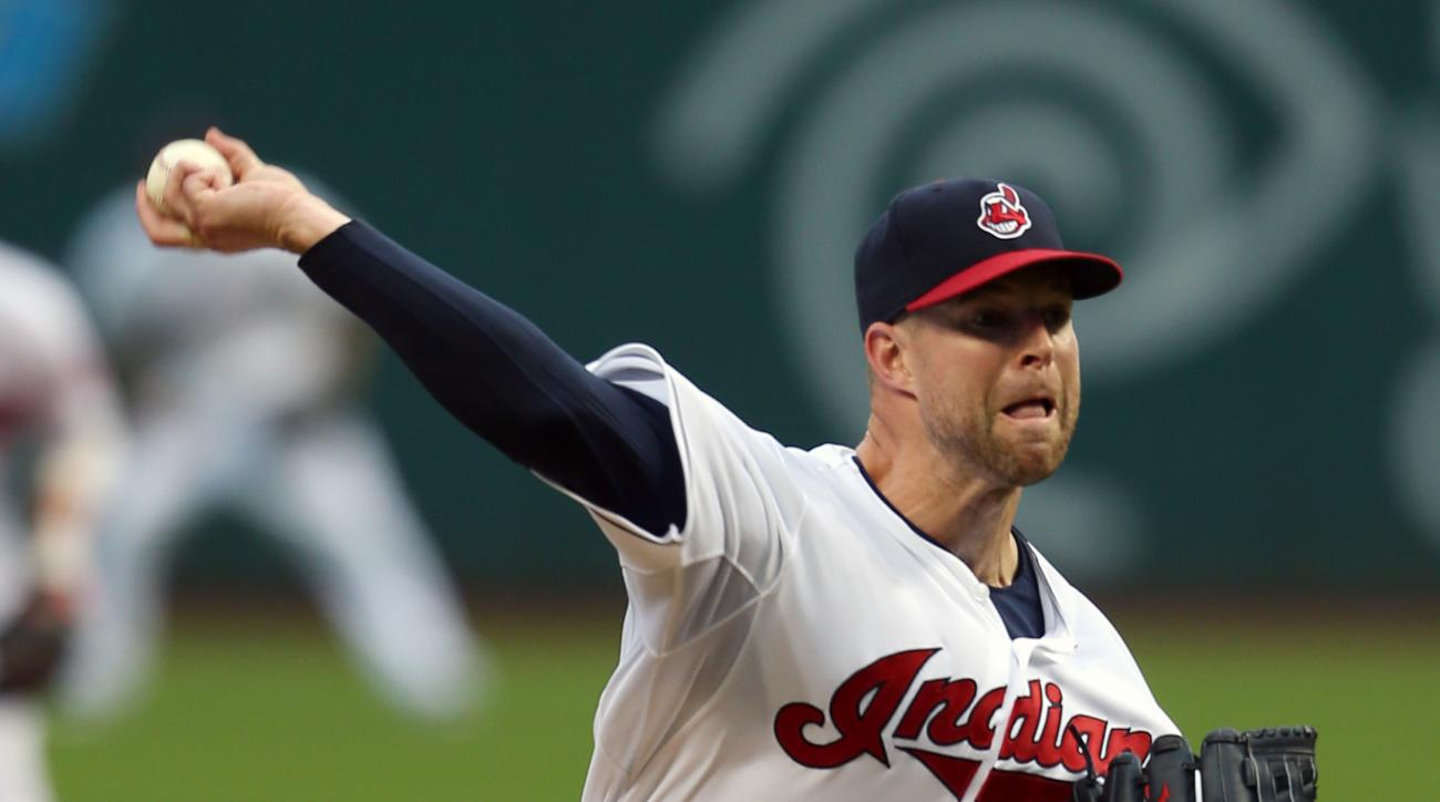 Cleveland Indians starting pitcher Corey Kluber pitches to Houston Astros' Preston Tucker during the first inning of a baseball game, Tuesday, July 7, 2015, in Cleveland. (AP Photo/Ron Schwane)