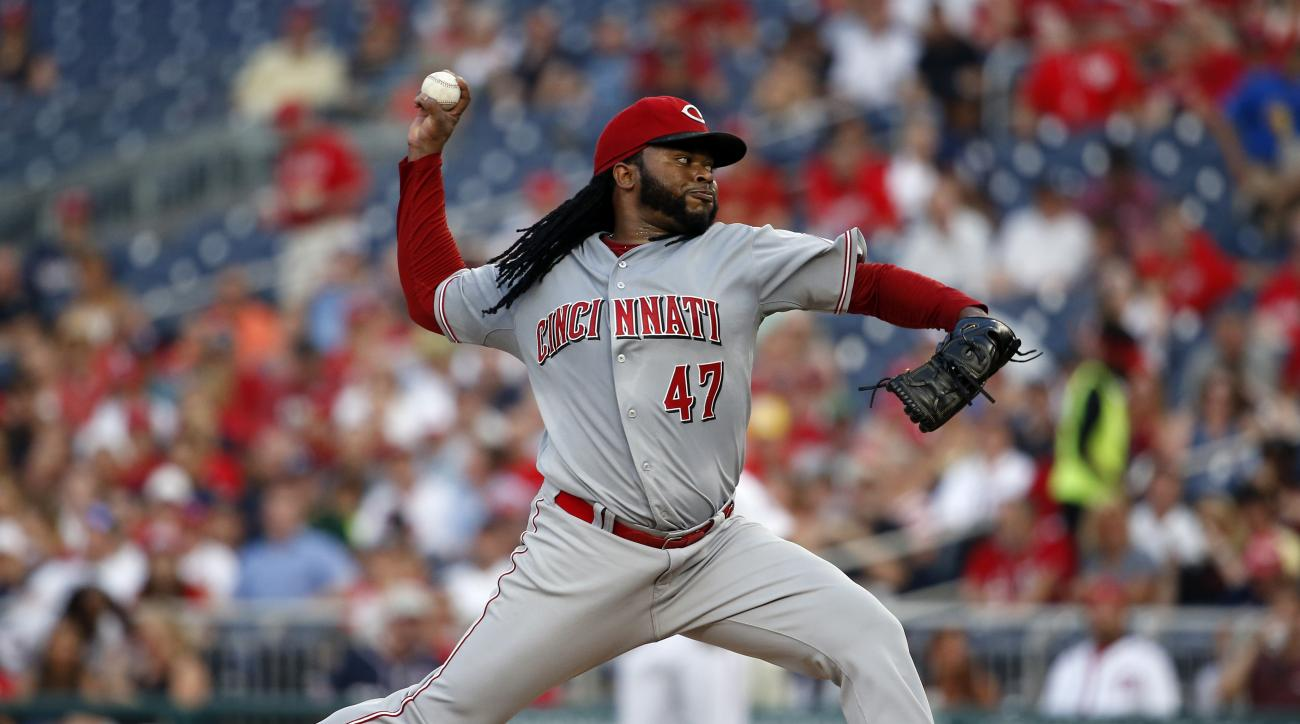 Cincinnati Reds starting pitcher Johnny Cueto throws during the fourth inning of a baseball game against the Washington Nationals at Nationals Park, Tuesday, July 7, 2015, in Washington. (AP Photo/Alex Brandon)