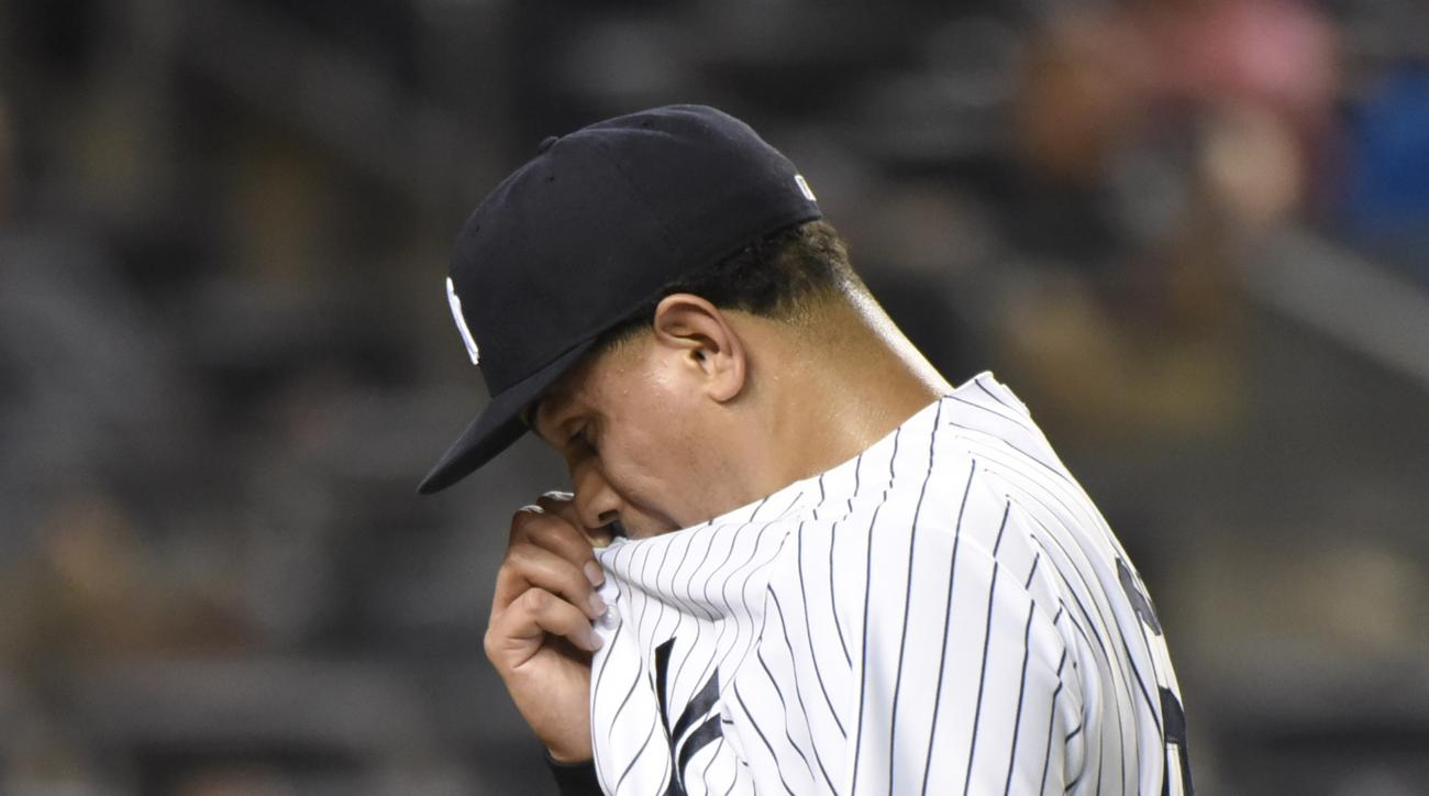 New York Yankees pitcher Dellin Betances reacts as he leaves the game after giving up a home run in the 10th inning of a baseball game against the Oakland Athletics Tuesday, July 7, 2015, at Yankee Stadium in New York. The Athletics defeated the Yankees 4