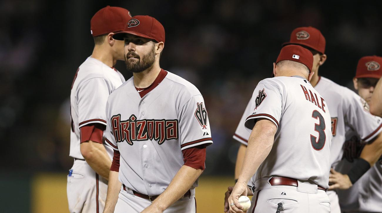 Arizona Diamondbacks' Robbie Ray, walks off the mound after handing the ball over to manager Chip Hale (3) during the eighth inning of an interleague baseball game against the Texas Rangers on Tuesday, July 7, 2015, in Arlington, Texas. The Diamondbacks w