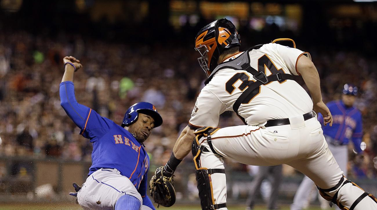 New York Mets' Curtis Granderson, left, is tagged out by San Francisco Giants catcher Andrew Susac during the sixth inning of a baseball game Tuesday, July 7, 2015, in San Francisco. Granderson was attempting to score on a fly ball hit by New York Mets th