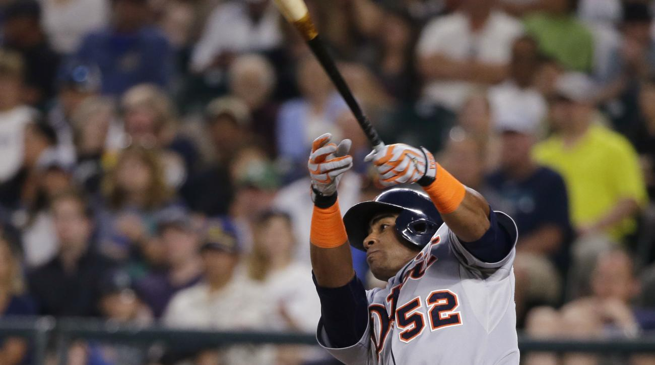 Detroit Tigers' Yoenis Cespedes hits a solo home run in the eighth inning of a baseball game against the Seattle Mariners, Tuesday, July 7, 2015, in Seattle. (AP Photo/Ted S. Warren)